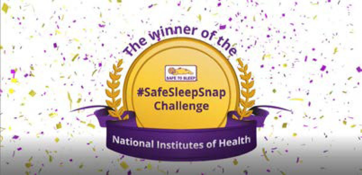 "Gold plate trophy illustration with the words  ""The winner of the #SafeSleepSnap Challenge: National Institutes of Health"",  with confetti in the background."