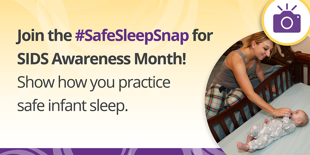 "Icon of a camera over an image of a woman sitting on an adult bed reaching into a clutter-free crib to give her baby a pacifier with the text, ""Join the #SafeSleepSnap for SIDS Awareness Month! Show how you practice safe infant sleep."""