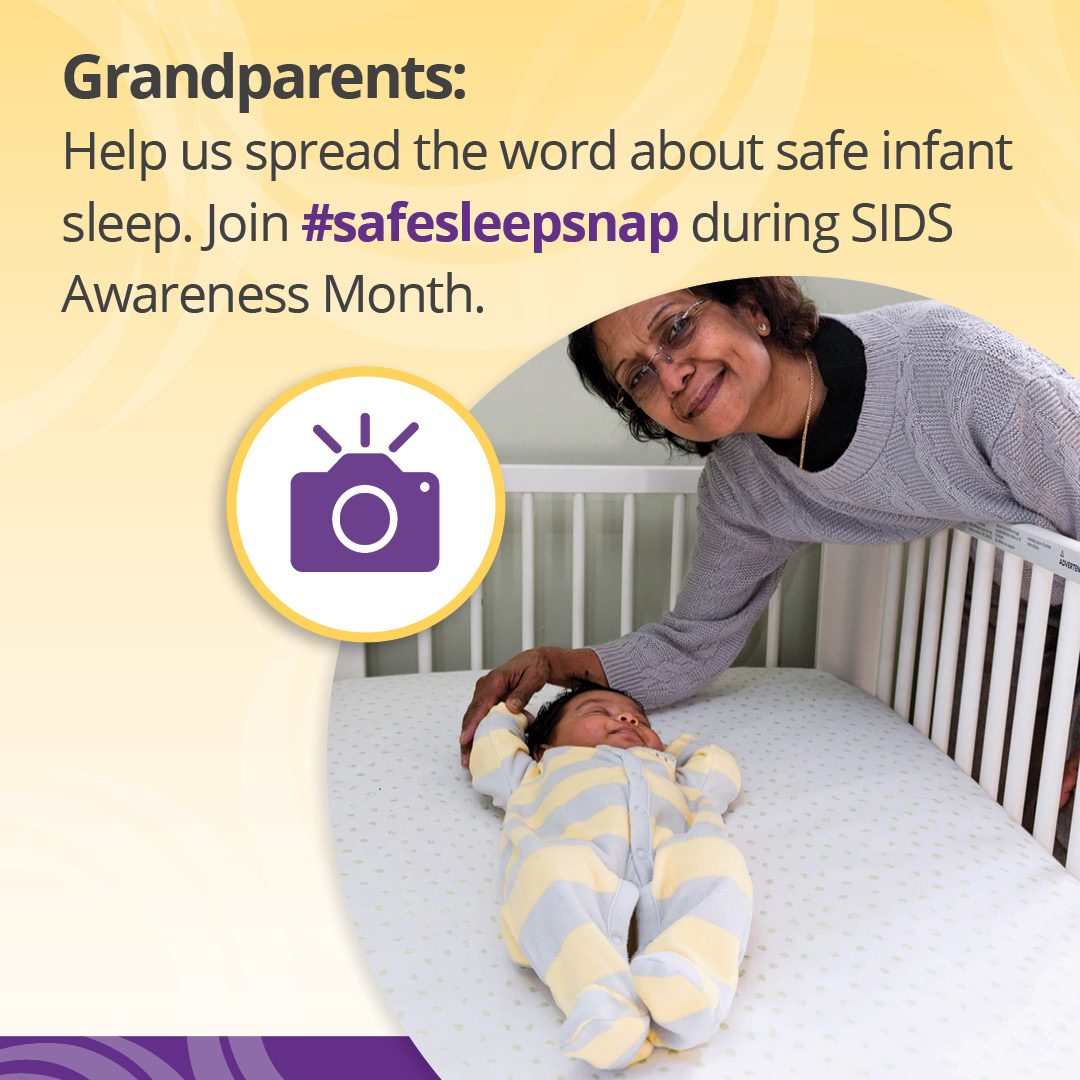 "Icon of a camera over an image of a grandmother leaning over a clutter-free crib to hold her grandbaby's hand with the text, ""Grandparents: Help us spread the word about safe infant sleep. Join #SafeSleepSnap during SIDS Awareness Month."""