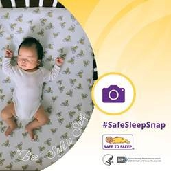 "Baby sleeping on her back on top of a fitted  sheet with bees on it, with the words ""Bee more Safe to Sleep"" #SafeSleepSnap,  an image of a camera, the Safe to Sleep logo, the HHS logo, and the NICHD logo."